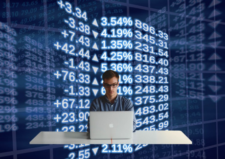 Image that shows a programmer in the stock exchange